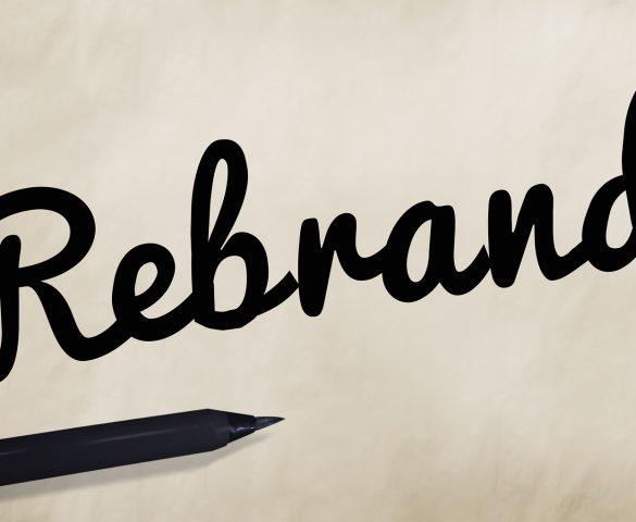 Rebrand written in black script on white background