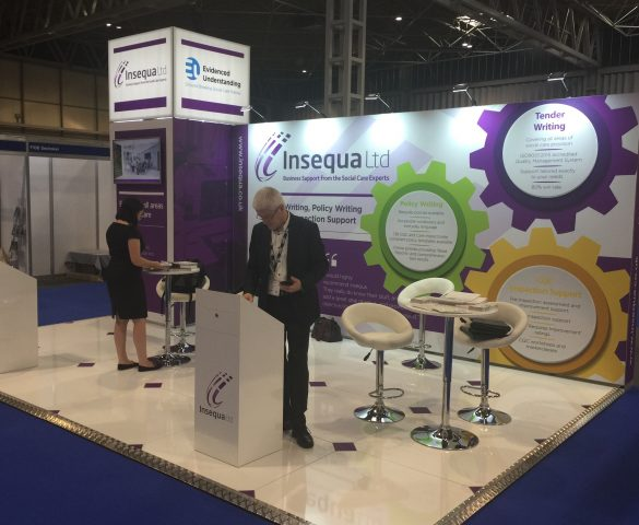 people on exhibition stand Care Show