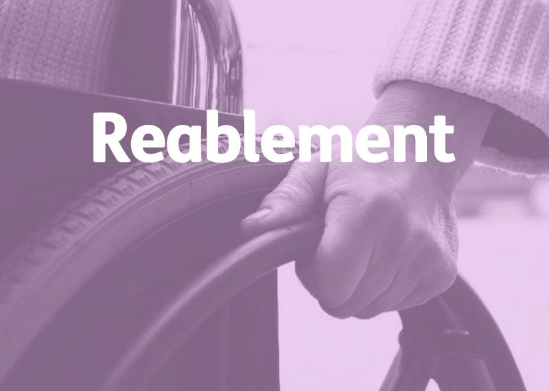reablement concept, elderly hand on wheelchair