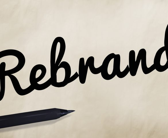 Rebrand written in black script on white background
